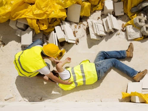 picture of a construction worer laying on the ground hurt