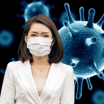 Asian woman wearing a white mask to protect against COVID-19