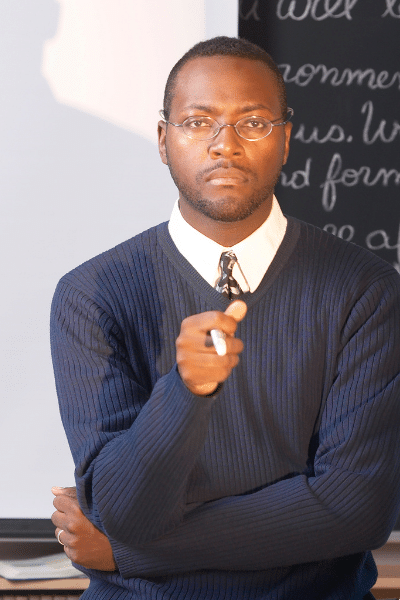 picture of an african american teacher - tenure law